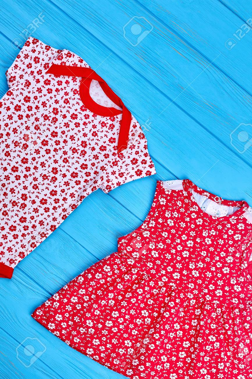 0ab1950700b Stock Photo - Toddler girl summer cotton clothes. Infant baby girl brand  summer clothing in red tone
