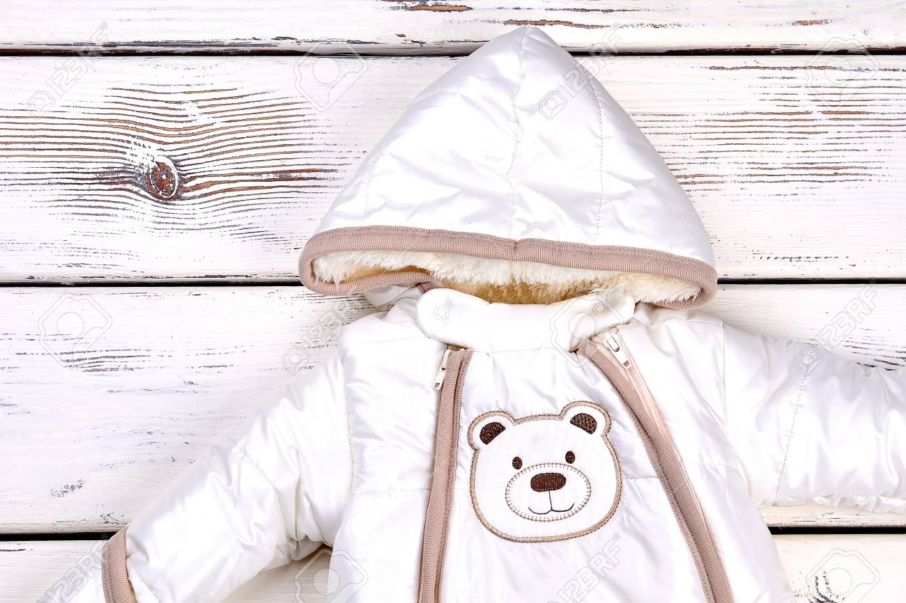 cf0fda426 Snowsuit for newborn baby. Baby girl or boy warm winter romper isolated on  old wooden