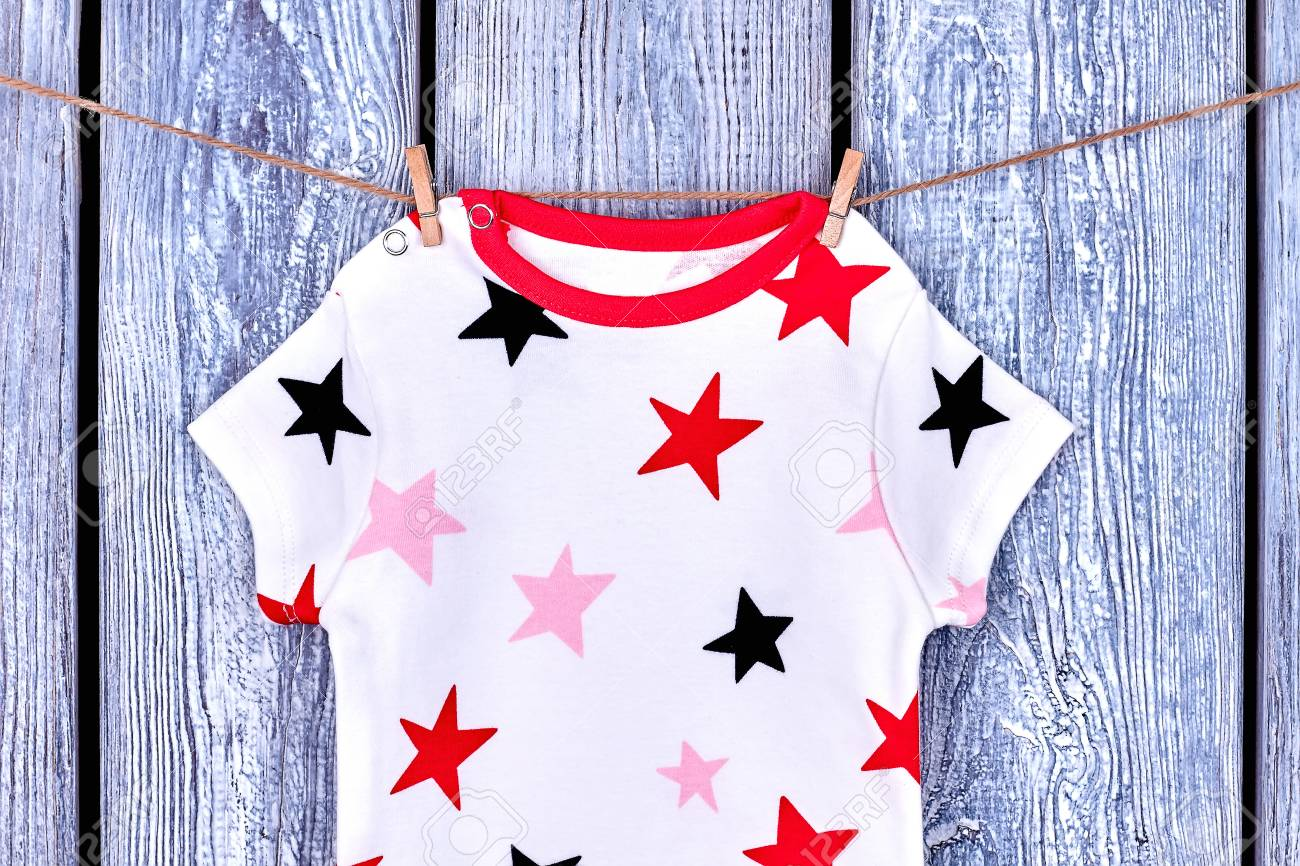 27f3a14898ca Infant baby printed t-shirt on rope. Newborn kids patterned clothes hanging  on clothesline