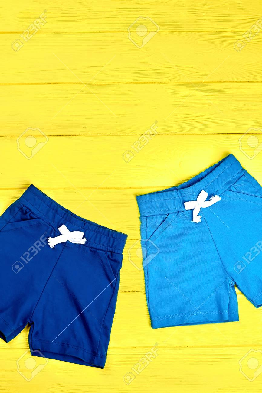 20b7548d7b Childrens casual shorts on yellow background. Set of kids comfortable..