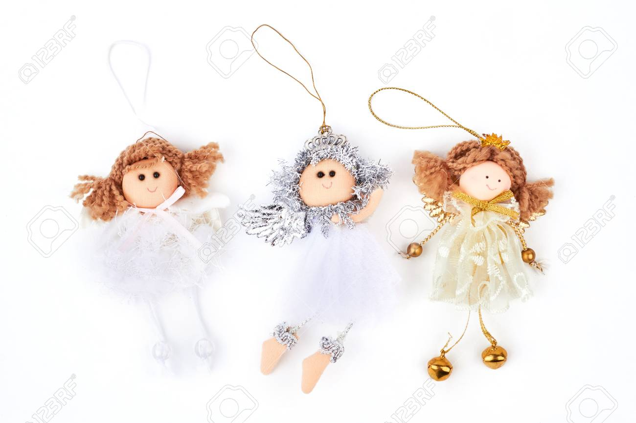 collection of christmas angels figurines three cute christmas angels decorations isolated on white background