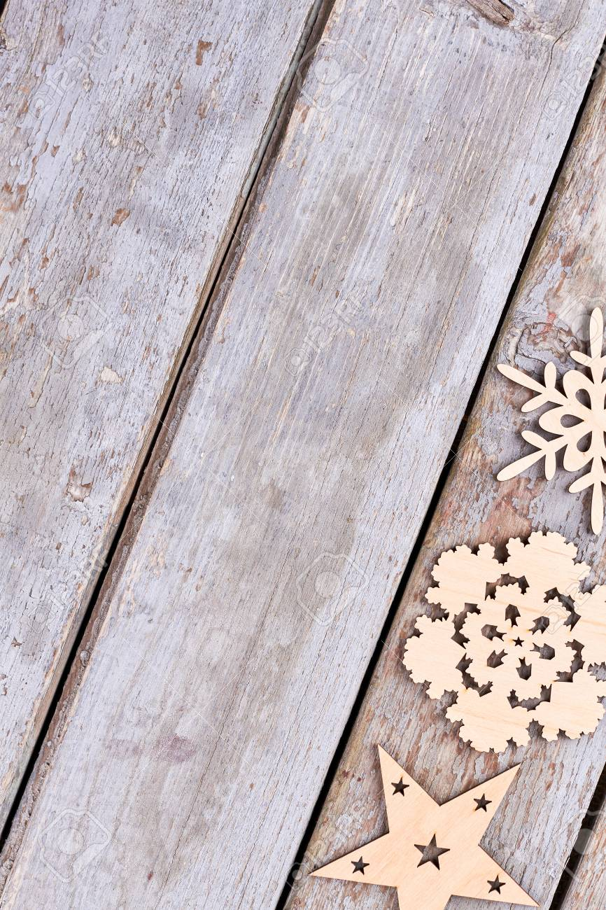 set of wooden christmas decorations top view cut out wooden snowflakes star on