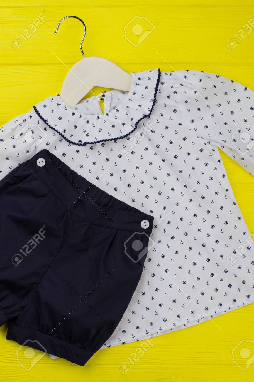 5ff522cb7623 Nice pajama for little girl. Nautical pattern on top with ruffle collar and  navy shirts