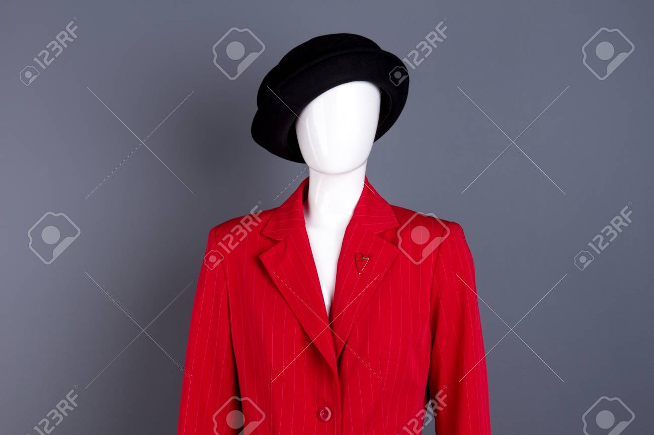 7f76fb472310f Female mannequin in elegant outfit. Black hat and red blazer..