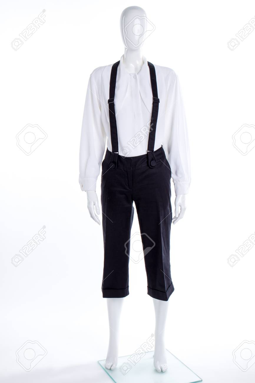 864a7627d Stock Photo - White shirt and black trousers with suspenders. Female  mannequin dressed in blouse and capri with braces.