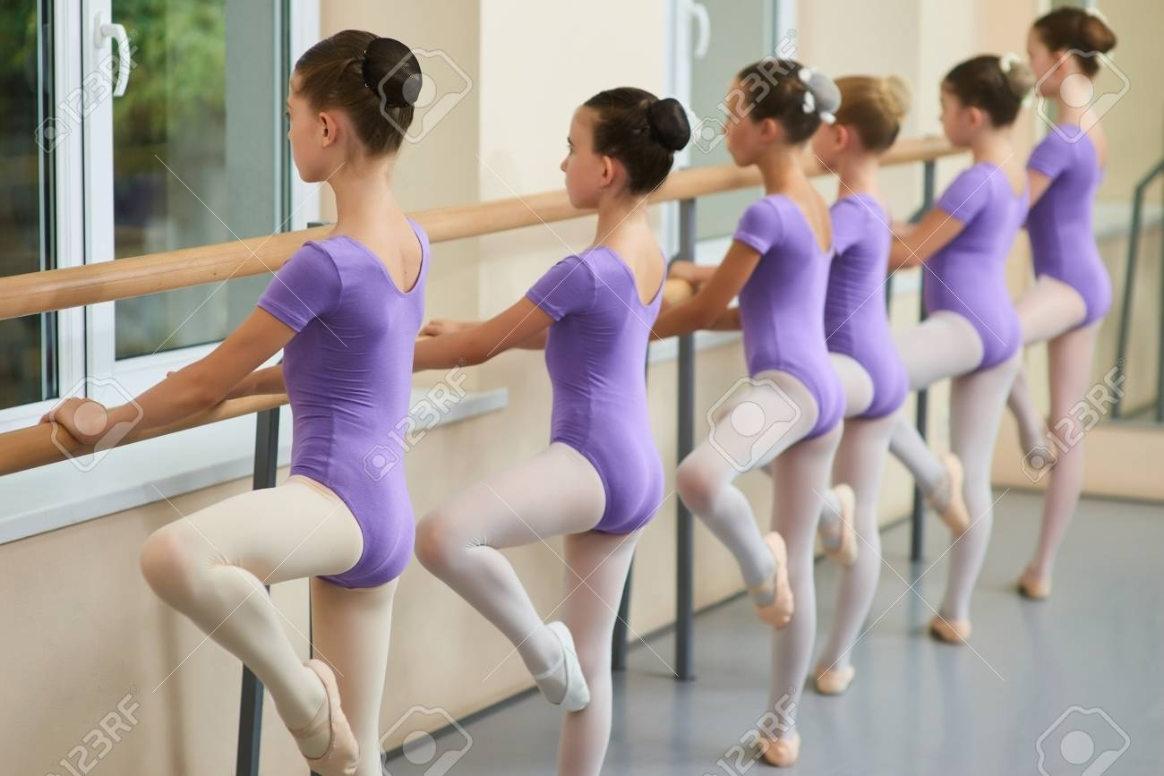 28f51c50d446 Young Ballerinas Training At Ballet Barre. Group Of Ballet Dancers ...