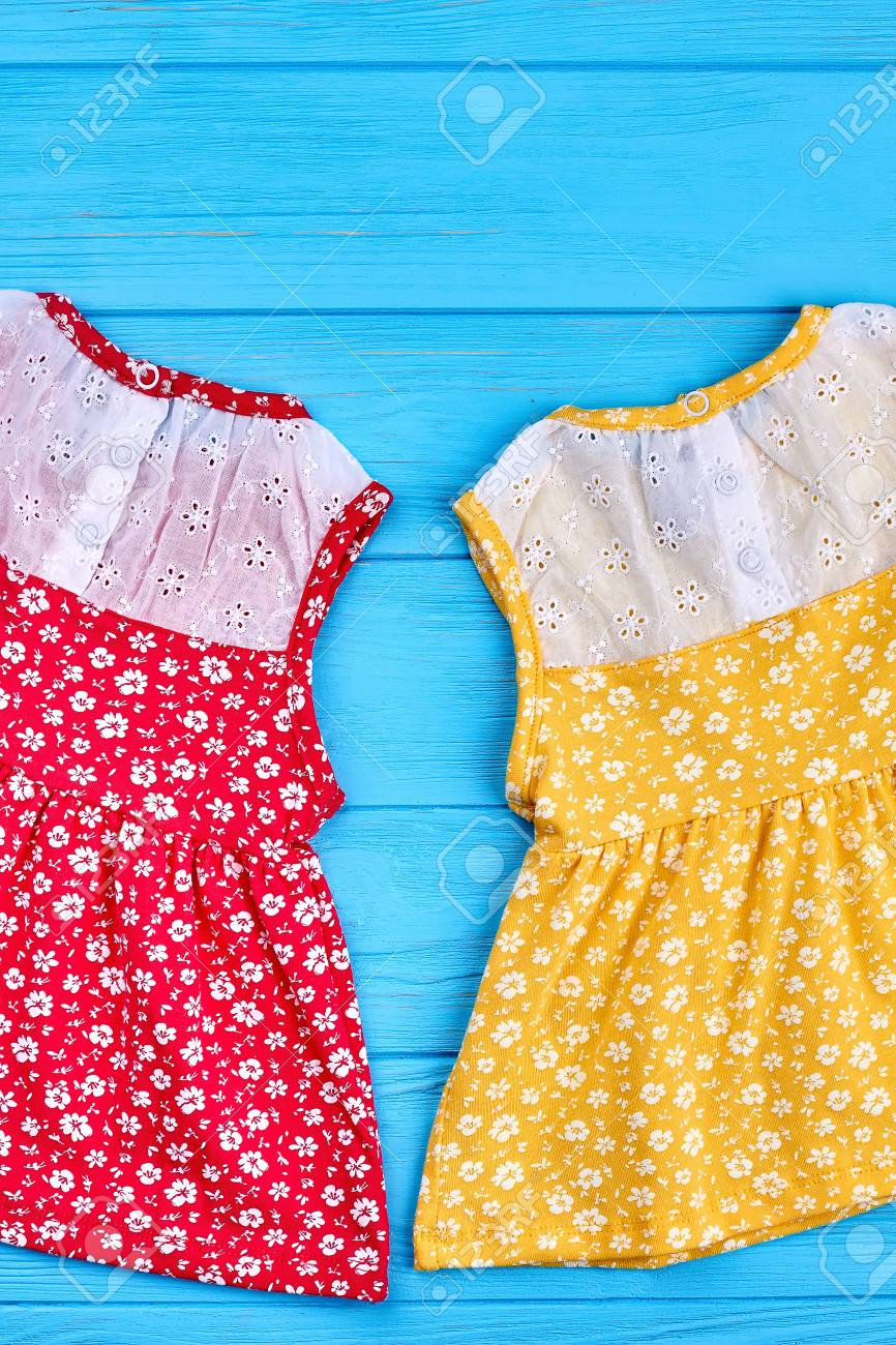Two baby dresses on summer background. Cotton dresses in small..