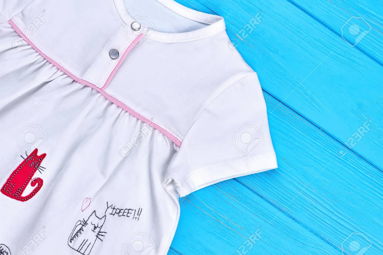 White Organic Cotton Dress For Baby Girl Close Up Of Baby Textile