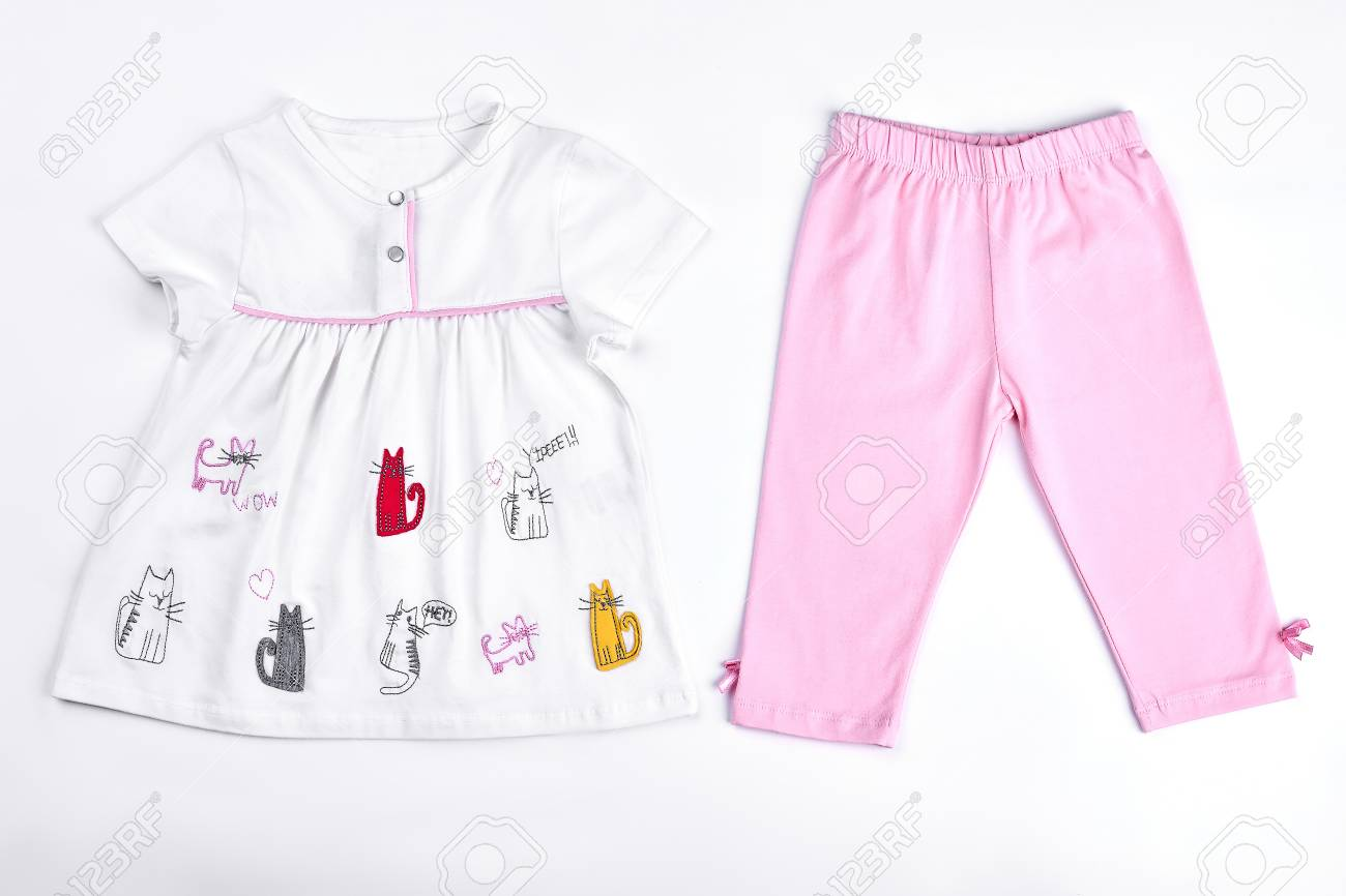 b656749c3719a Baby-girl dress and leggings. Newborn baby girl top and leggings on white  background