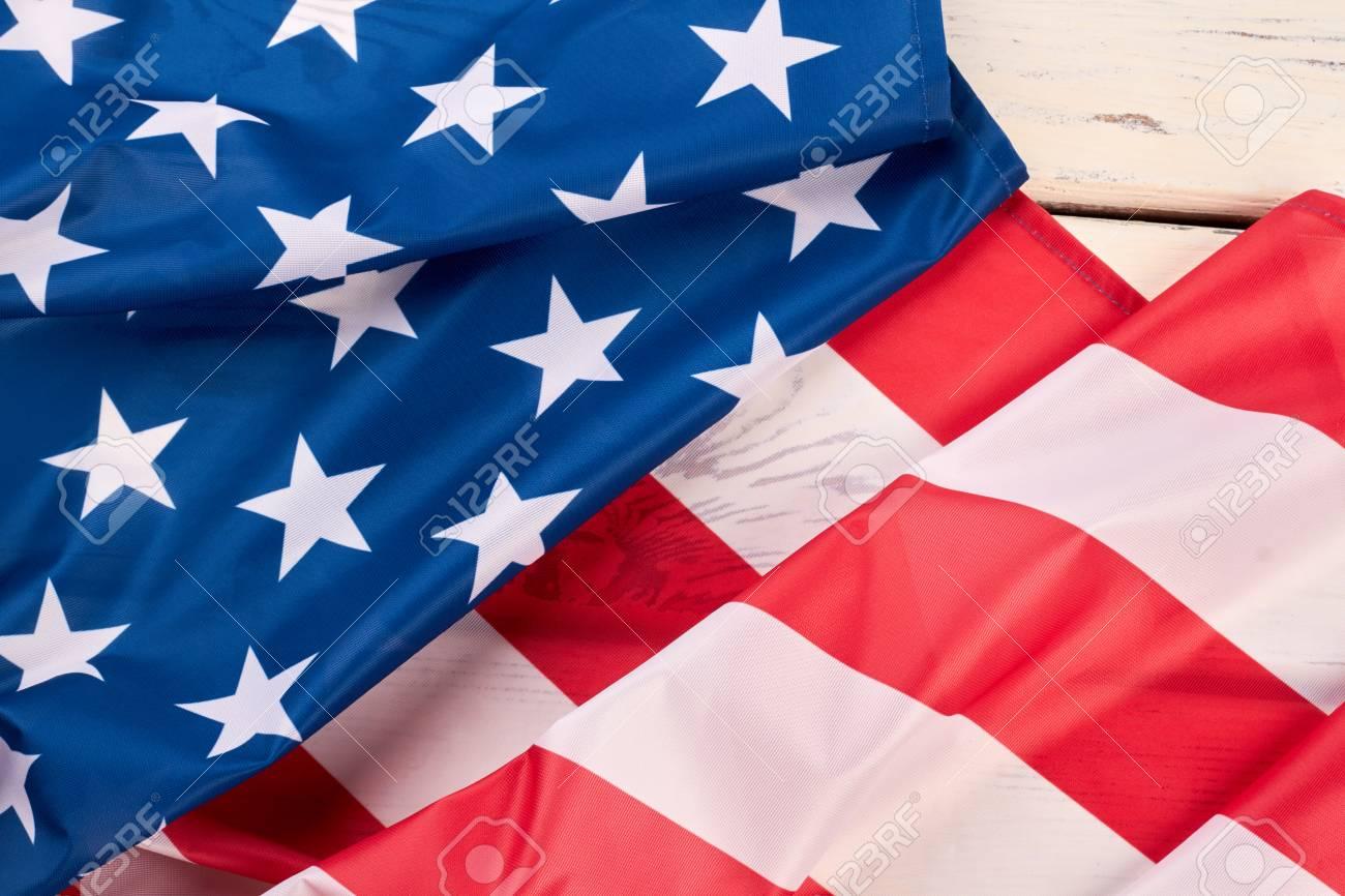 a4fdc314750e American satin flag close up. Stars and stripes flag. USA flag folded on  white