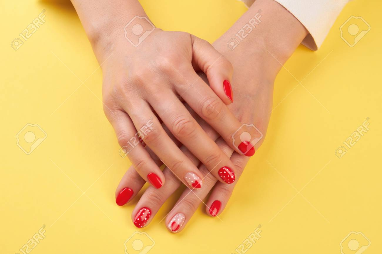 Manicured Hands Isolated On Yellow Background. Woman Hands With ...