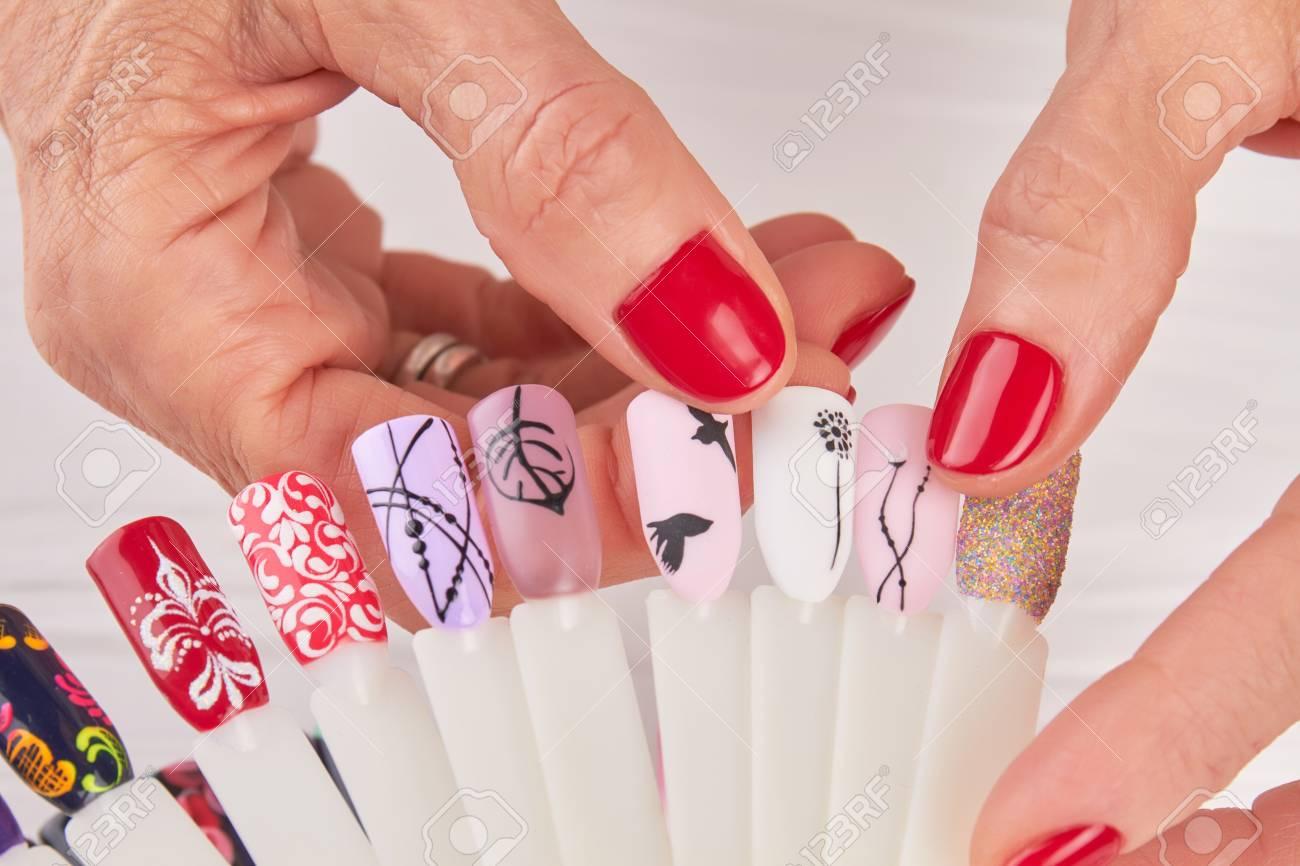 Manicured Hands Holding Nail Art Samples. Finger Nail Art Design ...