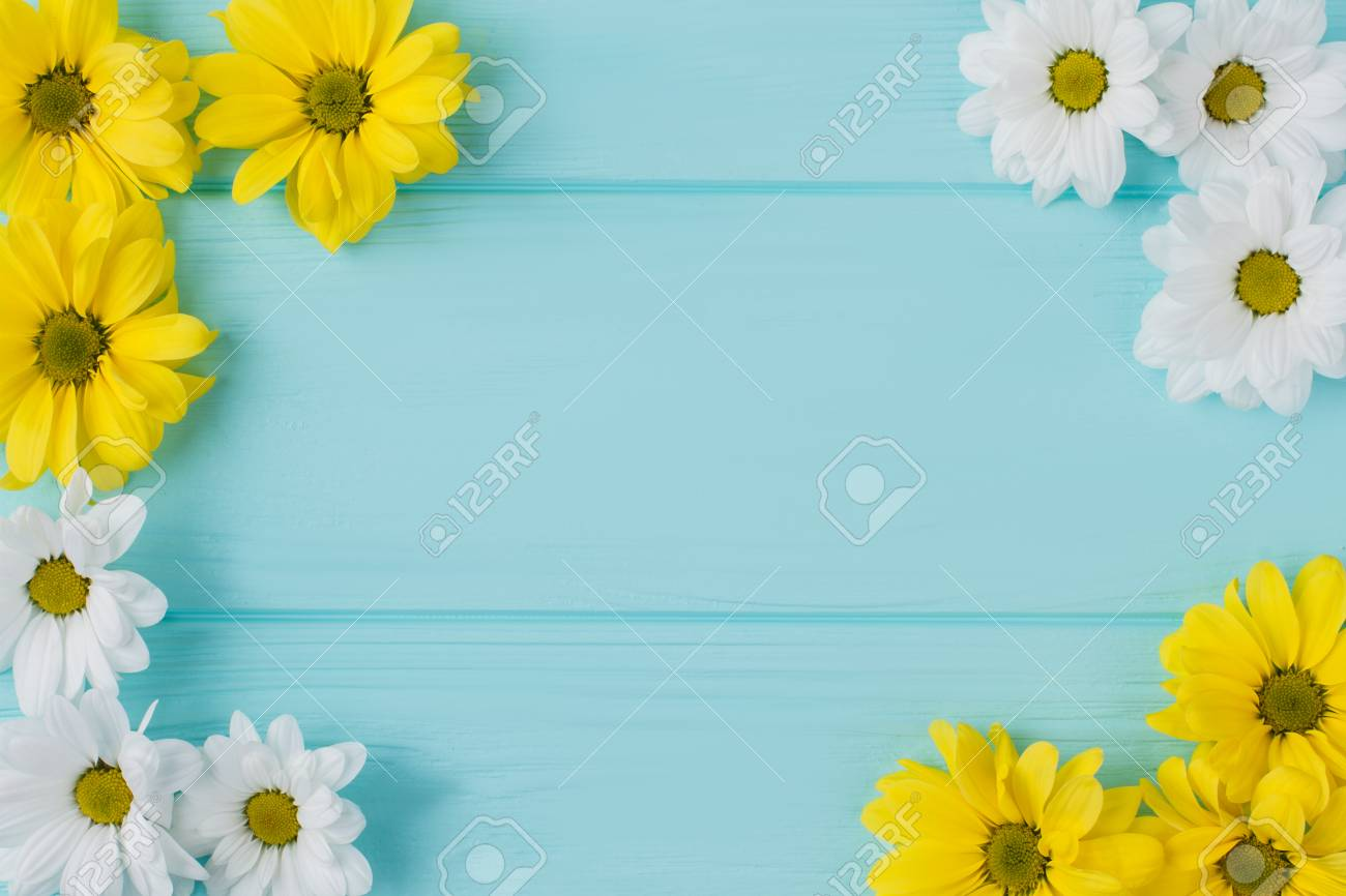 White And Yellow Flowers Round Composition Blue Wood Background