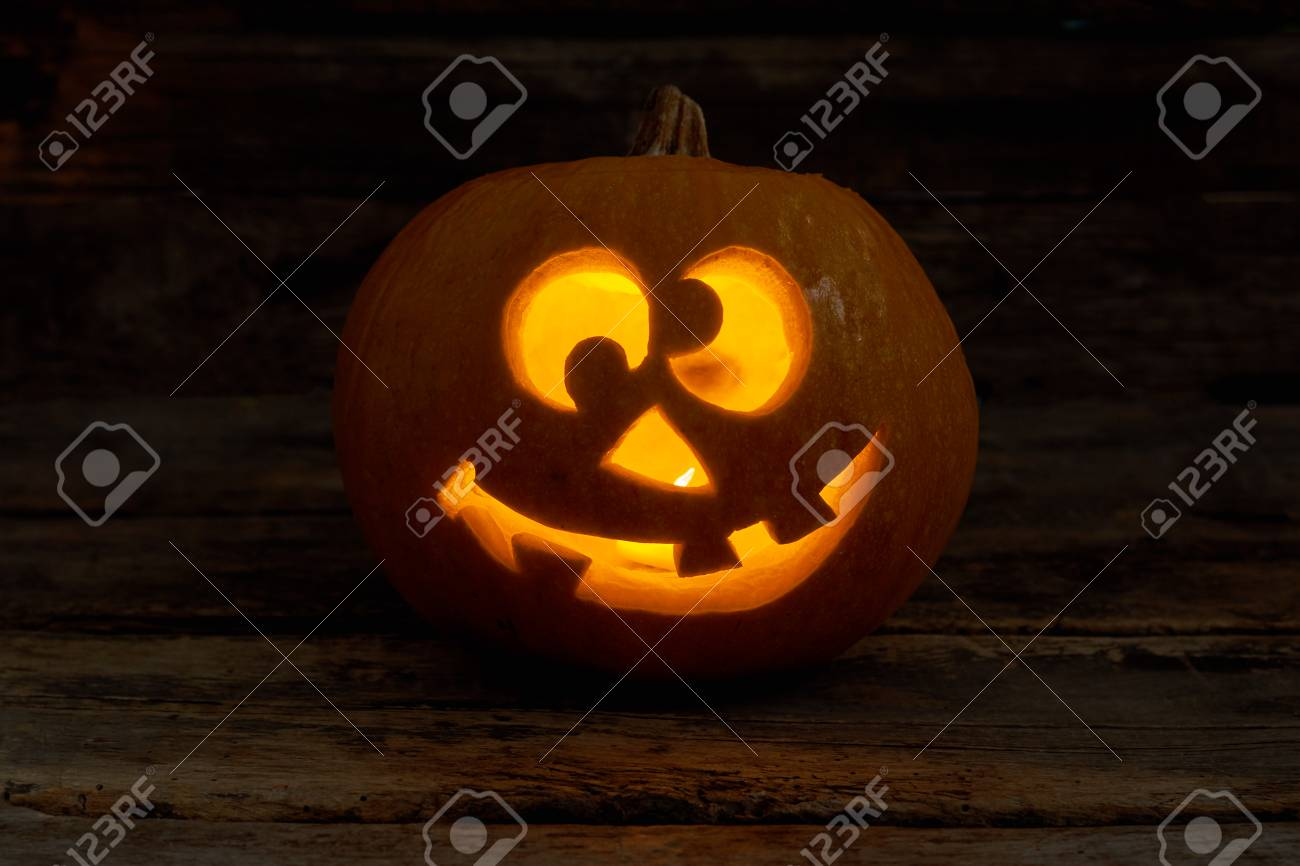Funny Jack O Lantern With Glowing Candle Halloween Pumpkin Face Stock Photo Picture And Royalty Free Image Image 109002422