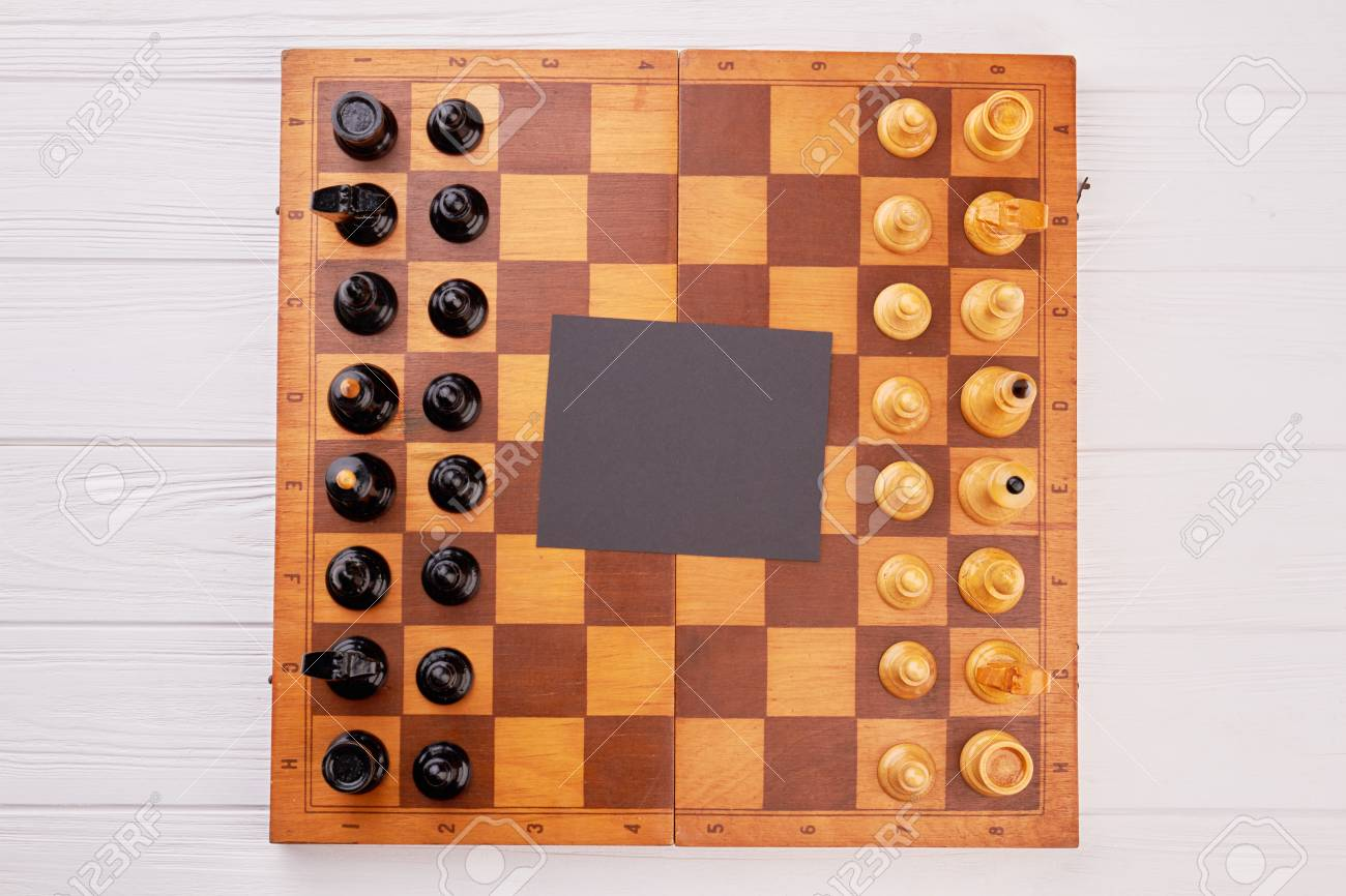 Classic wooden chess board with chess pieces  Chess set on game