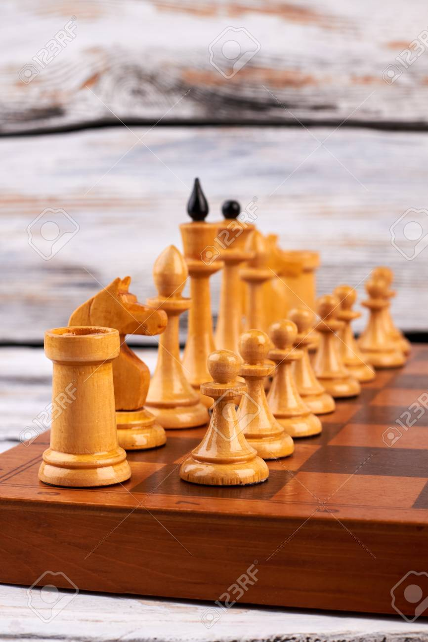 Wooden Chess Pieces On Chess Board Set Of White Chess Figures