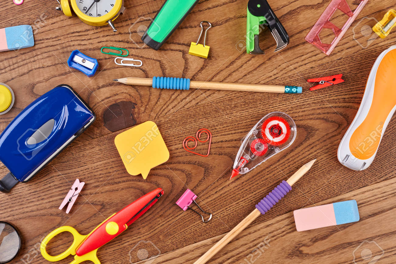 School background with different supplies. Various students accessories on wooden background. Education concept. - 126732091