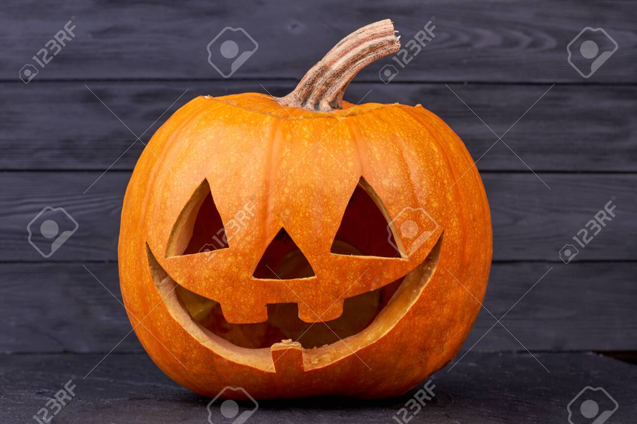 Jack O Lantern Decoration Halloween Pumpkin On Dark Background Stock Photo Picture And Royalty Free Image Image 130099403