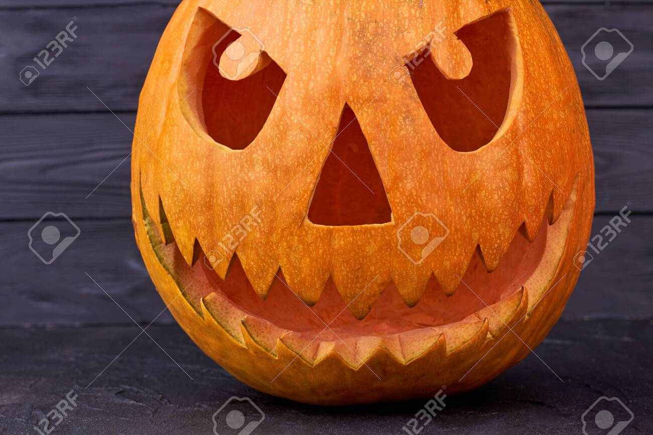 Scary Jack O Lantern Face On Dark Wooden Background Pumpkin Stock Photo Picture And Royalty Free Image Image 130099412