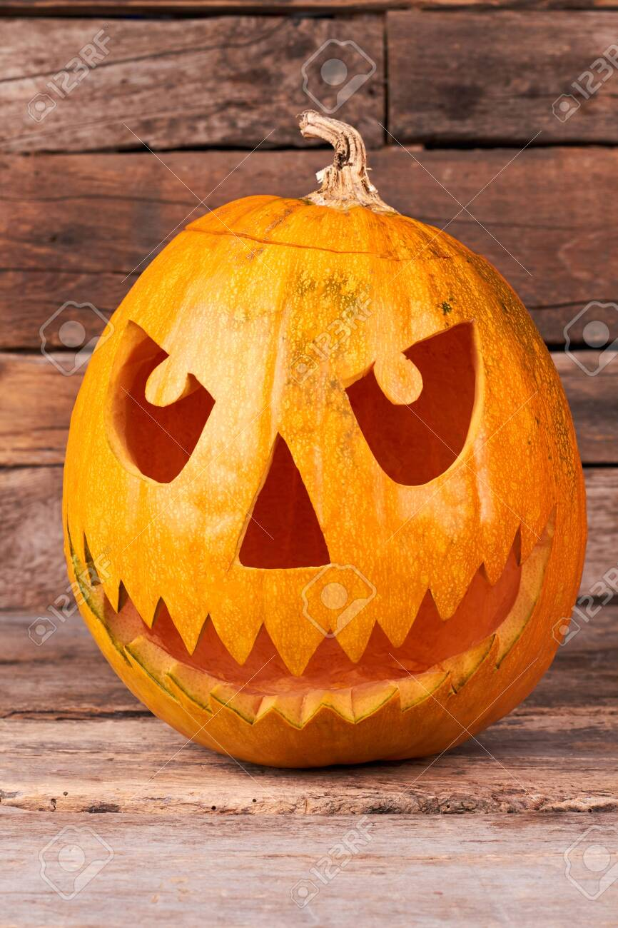Halloween Pumpkin Head With Scary Face Scary Pumpkin Carving Stock Photo Picture And Royalty Free Image Image 129950501