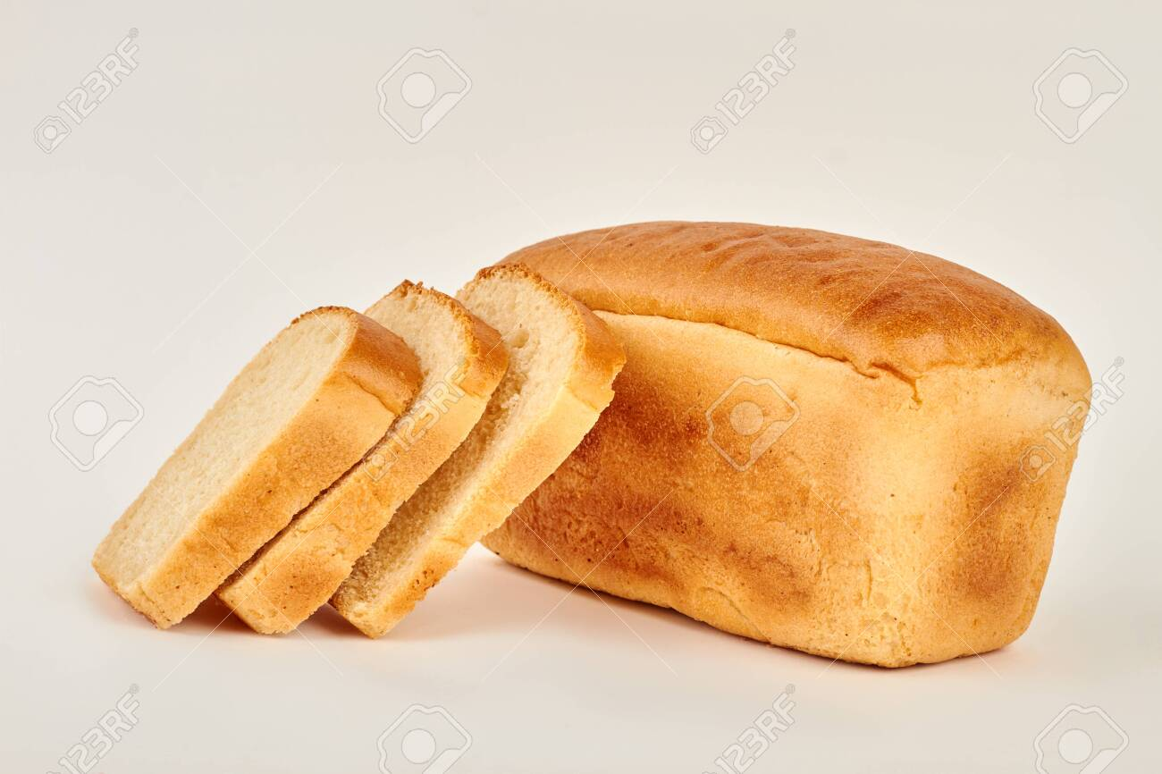 Loaf and slices of white bread. Freshly baked bread. - 135612153