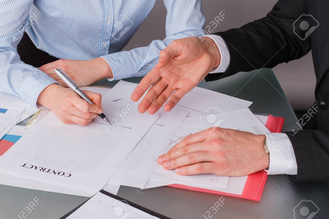Woman client putting signature on legal document. Female hand puts signature on business document making employment contract agreement. Investment or insurance deal after successful negotiation. - 156446119