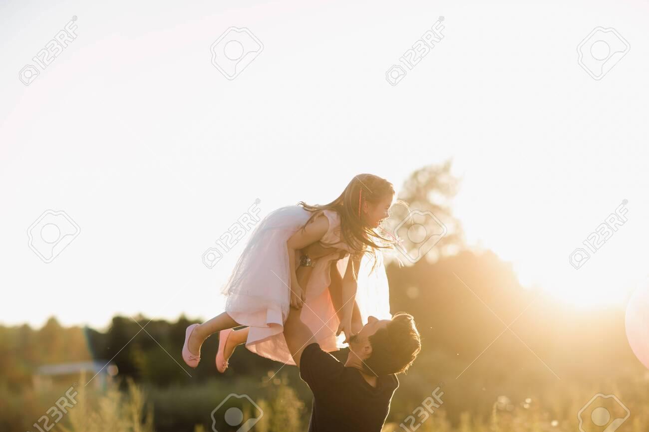 Fathers day. Happy family daughter hugs his dad on holiday in outdoor. - 146213155