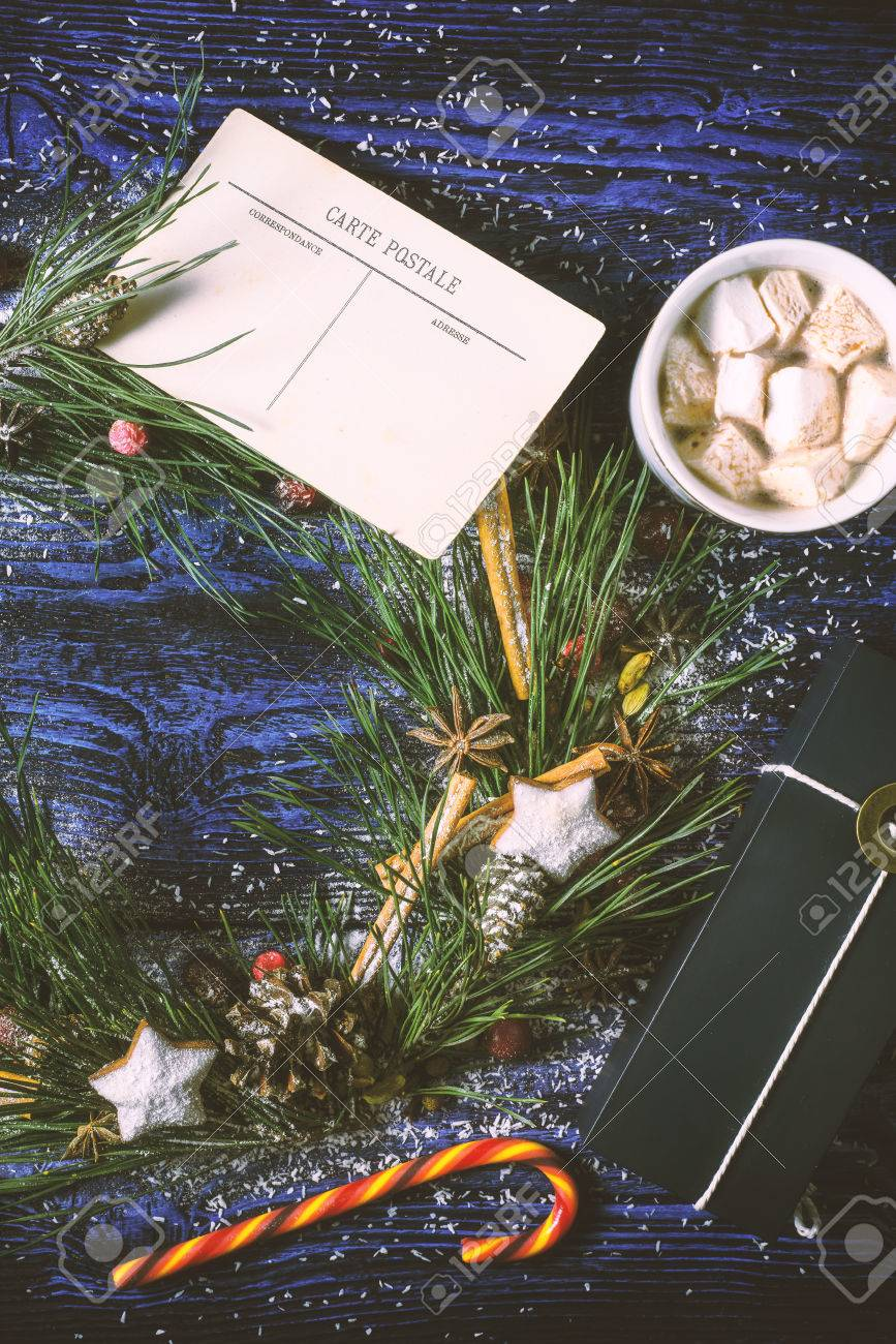 Christmas Wreath With Postcard And Present On The Wooden Background Vertical Stock Photo