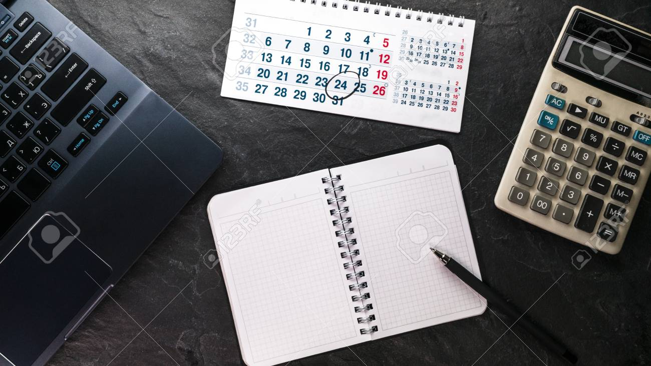 calculator and computer notebook and calendar free space stock
