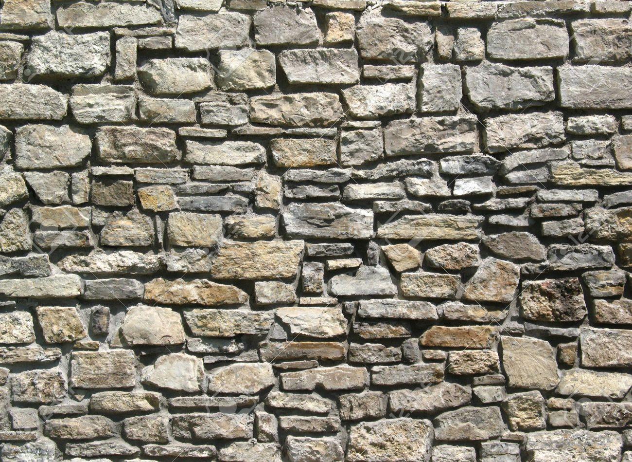 foto de archivo paredes irregulares de piedra natural para texturas