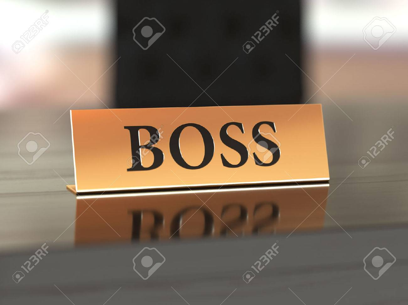 Golden nameplate with Boss text on the wooden table, with soft focus - 51539050