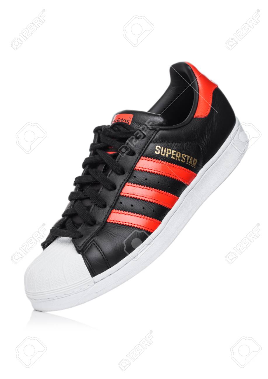 a7ea8157 LONDON, UK - JUNE 05, 2019: Adidas Originals Superstar black shoe with red
