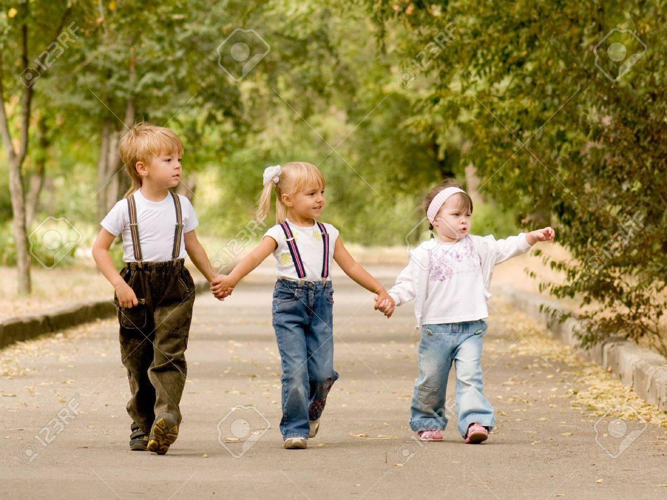 Three young friends go for a walk the park Stock Photo - 5675864