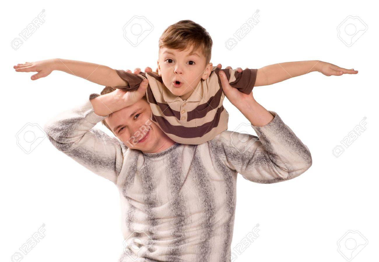 Portrait of loving father and his child cuddling on white background. Beautiful caucasian models. Stock Photo - 6720911