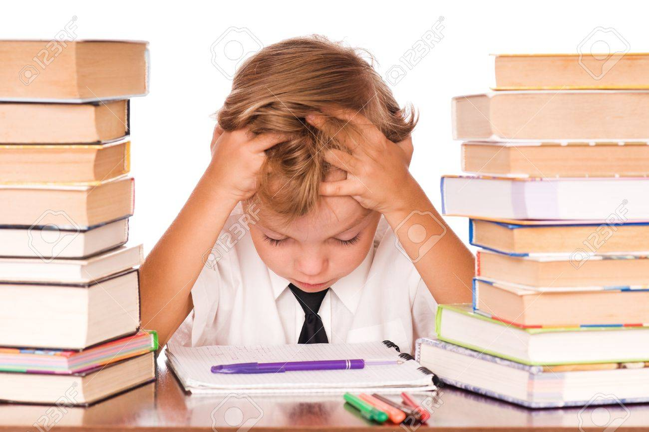 Portrait of a cute little boy sitting in library before books. Isolated over white background. - 7647372