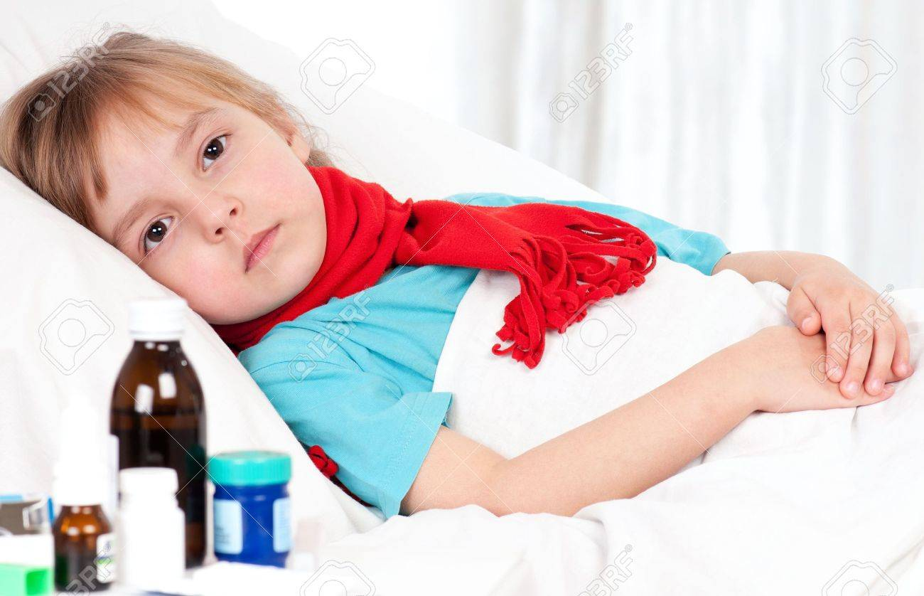 Sick little beautiful girl with red scarf in the bed Stock Photo - 9037064