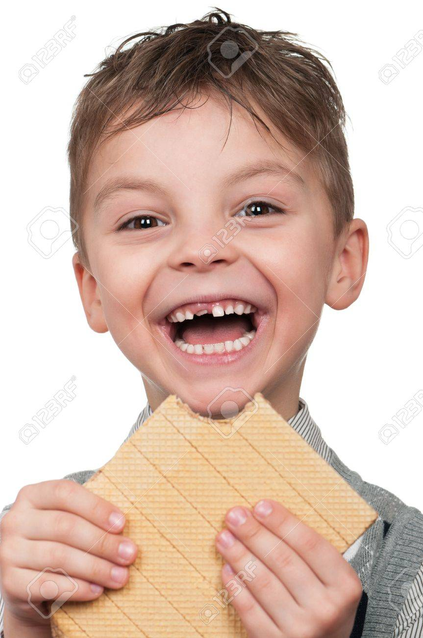 Portrait of a cute boy having a waffle - isolated on white Stock Photo - 9271489