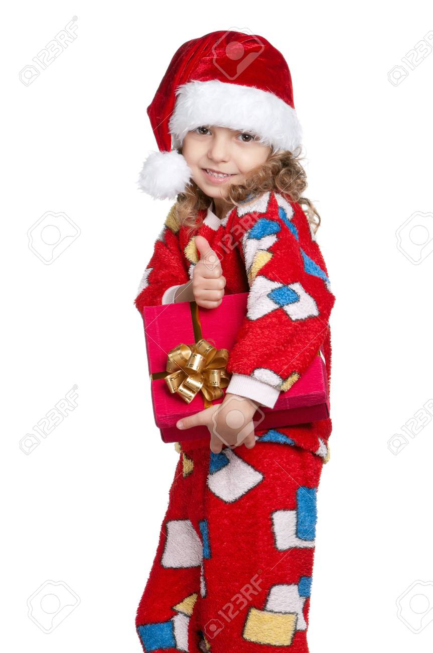 Portrait of happy Little girl in pajamas and santa hat with gift box over white background Stock Photo - 11464732