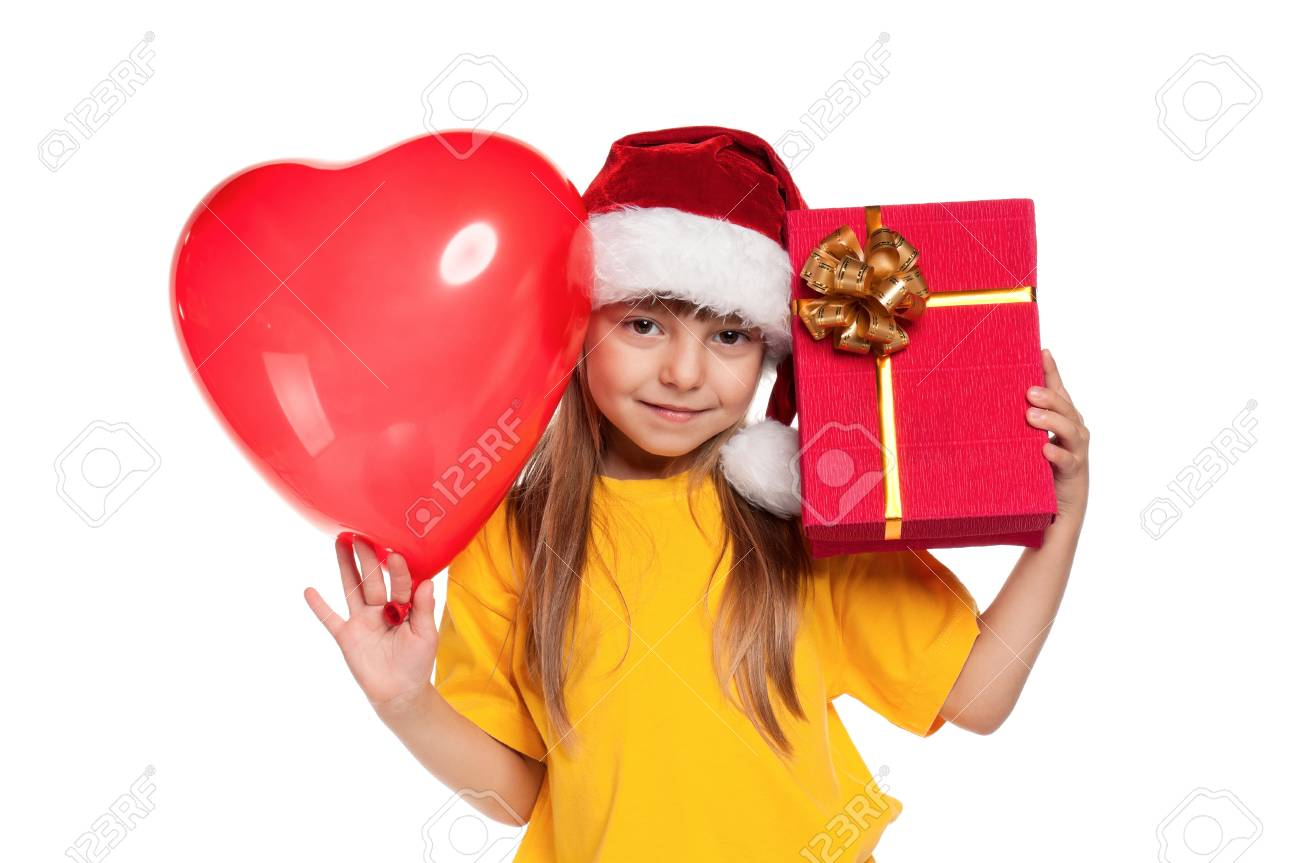 Portrait of little girl in santa hat with red heart balloon over white  background Stock Photo 8ca3d89e60e