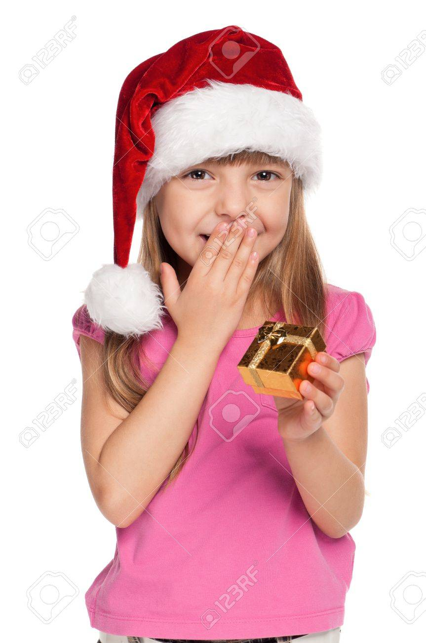 Portrait of happy little girl in santa hat with gift box over white background Stock Photo - 11479028
