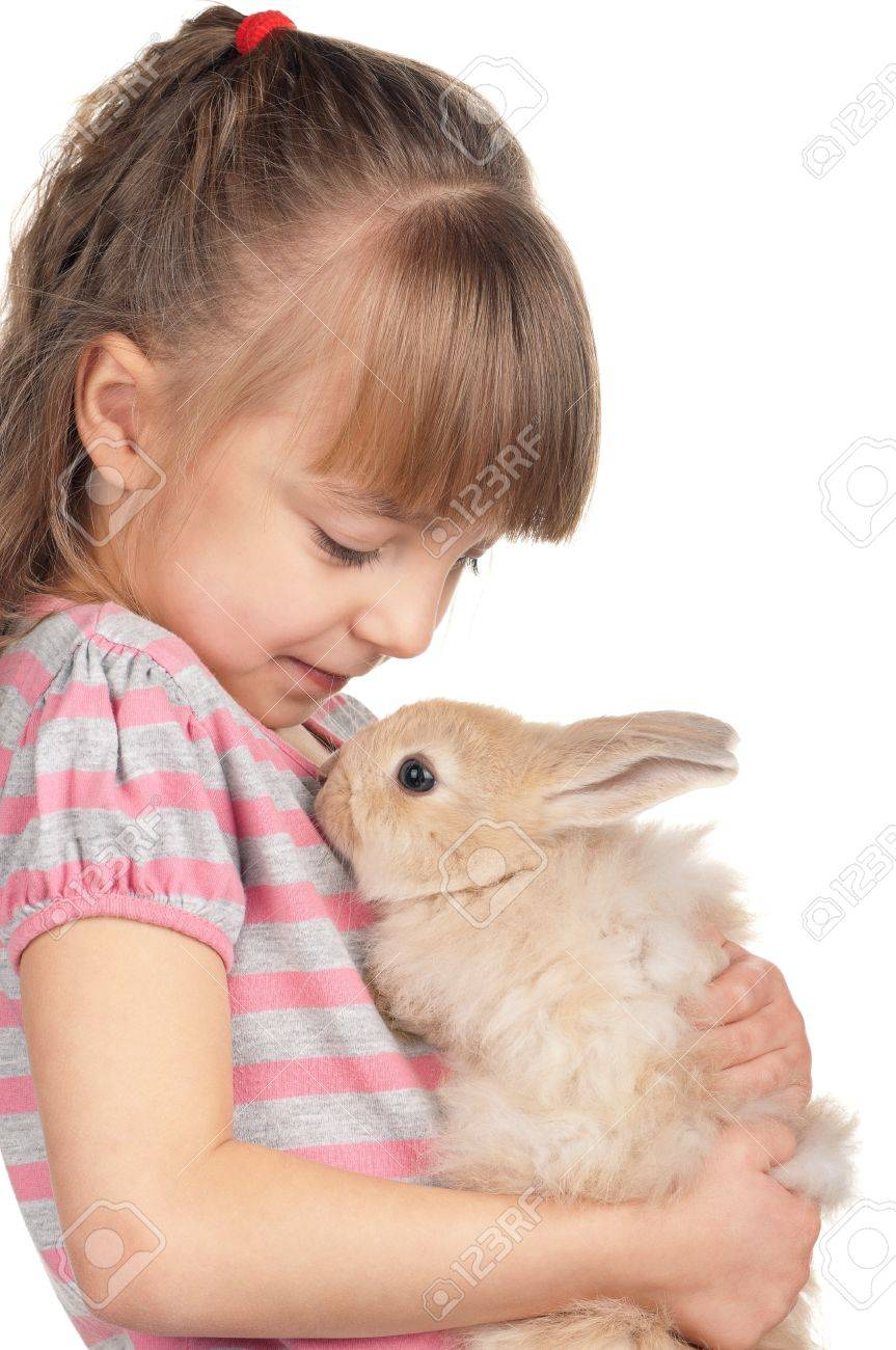 Easter concept image. Portrait of happy little girl with adorable rabbit over white background. Stock Photo - 12329511