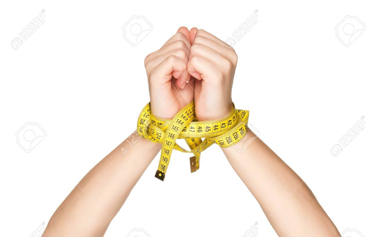 Woman hands with measure tape isolated on white background Stock Photo - 12562433