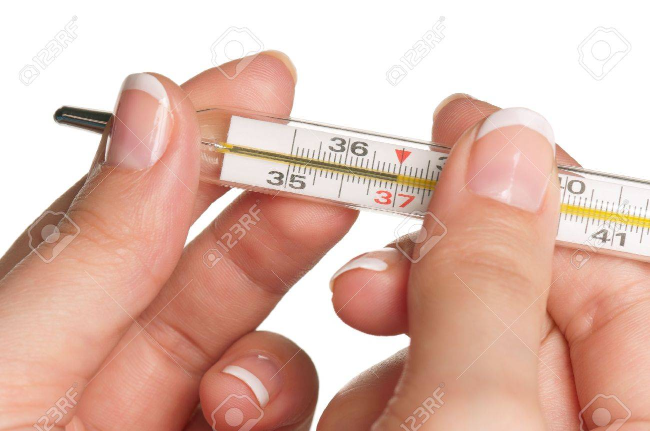 Woman hands with thermometer isolated on white background Stock Photo - 13221371