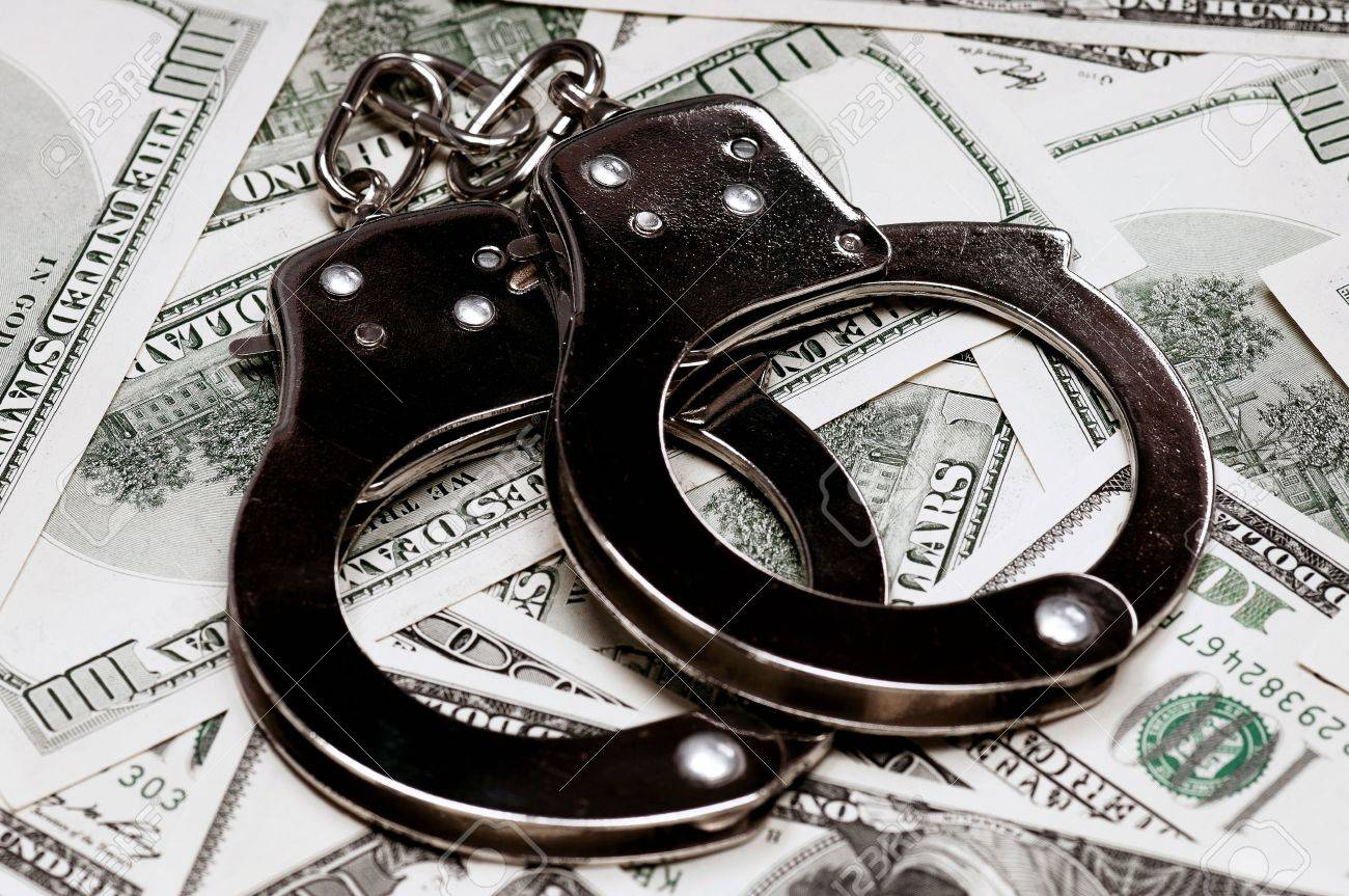Handcuffs on money background as security concept Stock Photo - 14765414