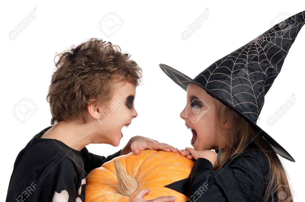 Boy and girl wearing halloween costume with pumpkin on white background Stock Photo - 14765808