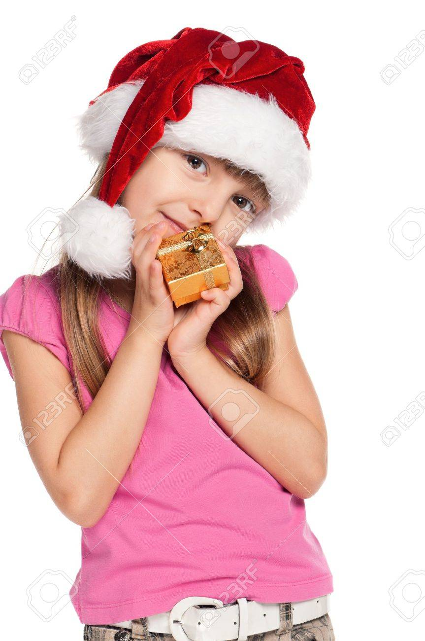 Portrait of happy little girl in santa hat with gift box over white background Stock Photo - 15556572