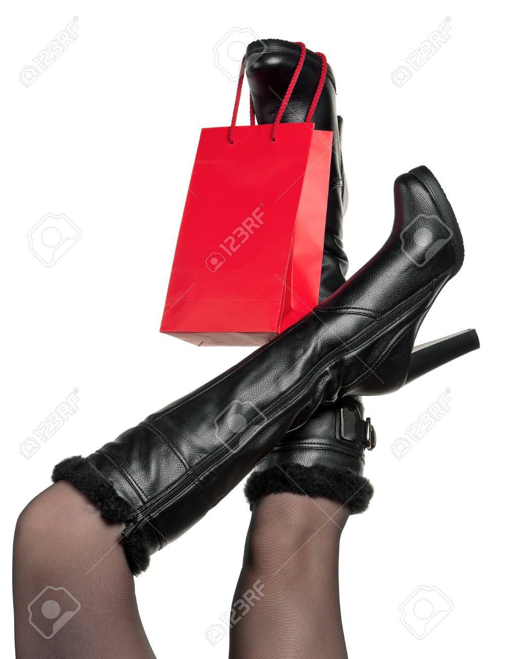 Detail of standing woman wearing fashionable black boots posing on white Stock Photo - 15597731
