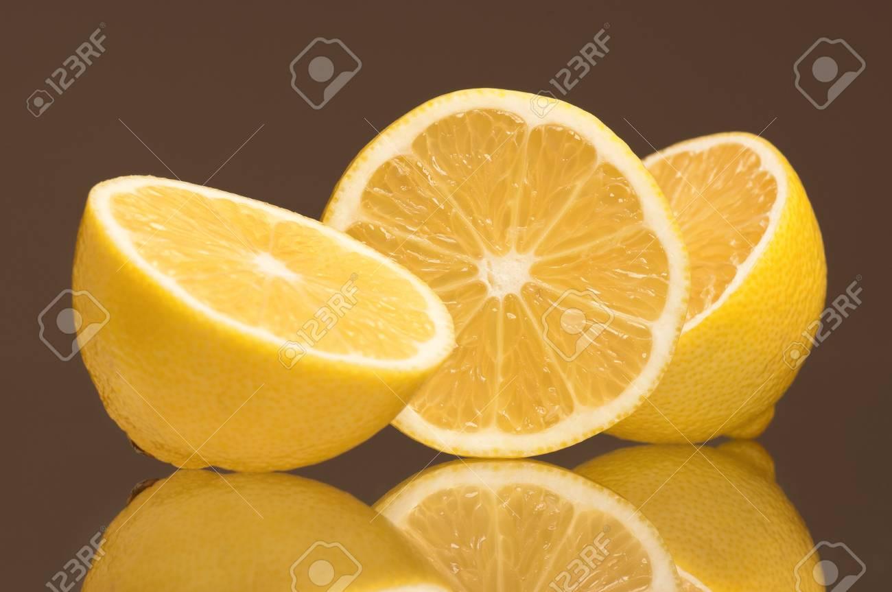 Slice of fresh lemons isolated on grey background Stock Photo - 15823322
