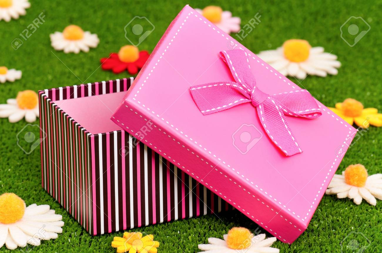 Gift box with bow on artificial green grass Stock Photo - 16384953