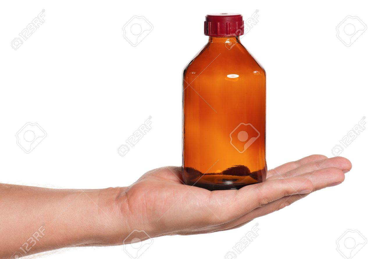 Man hand with small bottle isolated on white background Stock Photo - 16384360